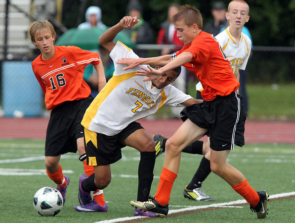 Bishop Fenwick Rishad DeSilva, center, fights for the ball with Beverly's Jake Bettencourt, left, and Dylan Perry, right, on Tuesday afternoon. David Le/Staff Photo