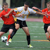 Bishop Fenwick's Iftimi Arapi, center, fights for the ball against Beverly's George Hillios, left, and Dylan Perry, right, during their game on Tuesday afternoon at Bishop Fenwick High School. David Le/Staff Photo