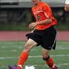 Beverly midfielder Jake Bettencourt plays the ball upfield against Bishop Fenwick. David Le/Staff Photo