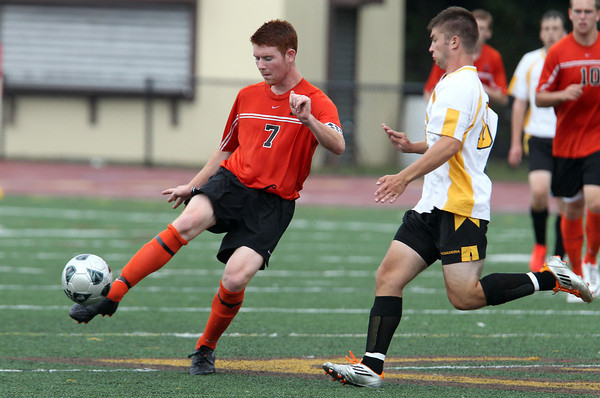Beverly's Conor Leahy, left, plays the ball off a bounce while being pressured by Bishop Fenwick's Tyler Fouhey, right, on Tuesday afternoon. Leahy scored twice for the Panthers as they defeated the Crusaders. David Le/Staff Photo