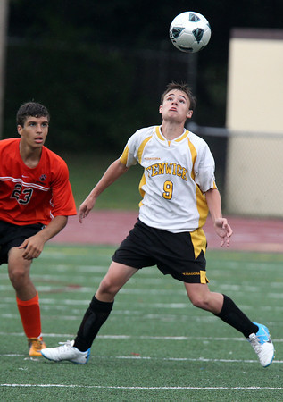 Bishop Fenwick's James Brophy, right, keeps his eyes on the ball, while being defended by Beverly's Bryon Gerard. David Le/Staff Photo