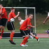 From left, Beverly High School defenders Karl Zeroka, Graham Doherty, Conor Leahy, and Cam Rogers, jump and try to block a shot from Bishop Fenwick's Rishad DeSilva, on Tuesday afternoon. David Le/Staff Photo