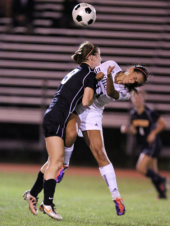 Beverly junior captain Diandra Crowley, left, and Salem sophomore forward Deema Hijleh, right, collide in midair while competing for a head ball on Tuesday evening. David Le/Staff Photo