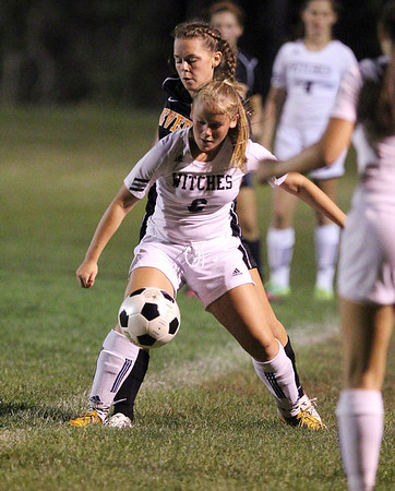 Salem sophomore midfielder Sydney Hanford, right, controls the ball while being pressured by Beverly's Rose Terner, left, on Tuesday night. David Le/Staff Photo