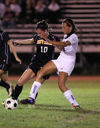 Beverly junior Kristen O'Connor, left, and Salem's Deema Hijleh, right, battle for a 50/50 ball during their game on Tuesday evening at Bertram Field in Salem. David Le/Staff Photo
