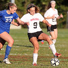 Marblehead sophomore Mia Bongiorno, right, tries to keep control of the ball while holding off Danvers senior Meghan Kenny, left, on Thursday afternoon. David Le/Staff Photo