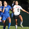 Danvers senior captain Renee Pohle, left, and Marblehead freshman Sarah Cullen, right, battle for a header on Thursday afternoon at Piper Field in Marblehead. David Le/Staff Photo