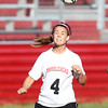 Marblehead senior Kiley Fischer winces as she heads the ball upfield against Danvers on Thursday afternoon. David Le/Staff Photo