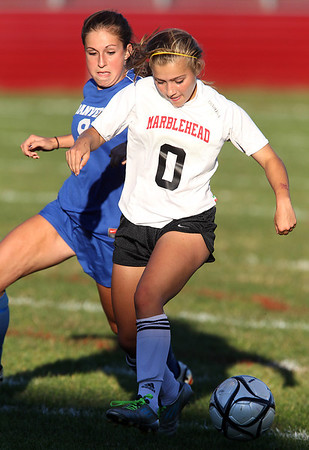 Marblehead freshman Sarah Cullen, right, shields the ball from Danvers senior Renee Pohle, left, on Thursday afternoon. David Le/Staff Photo