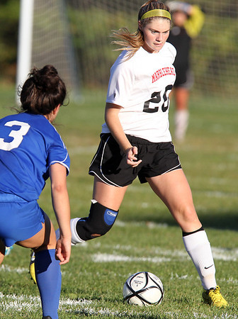 Marblehead senior Rebecca Unterborn looks to pass the ball upfield against Danvers. Marblehead got out to an early 1-0 lead on a goal by sophomore Mia Bongiorno, but the Falcons rallied back for 2 consecutive goals to defeat the Headers 2-1 at Piper Field on Thursday afternoon. David Le/Staff Photo