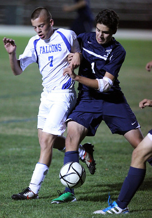 Danvers senior midfielder Chris Durgin, left, and Swampscott senior defense Alex Zuchero, right, get tangled up as they try and gain possession of the ball on Thursday evening. The Falcons handily beat the Big Blue 8-1 behind a 4 goal 1 assist performance from senior captain Eric Martin. David Le/Staff Photo