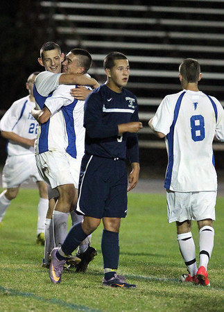 Danvers High School senior captain Eric Martin, left, gets a hug from teammate Nick Lebel after he netted his 4th goal of the game and 100th point of his career. Martin's 4 goals and 1 assist led the Falcons to a 8-1 victory over Swampscott on Thursday evening at Deering Stadium. David Le/Staff Photo