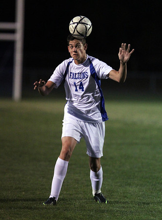 Danvers High School junior defender Caio Silva heads the ball towards a teammate on Thursday evening against Swampscott. The Falcons downed the Big Blue 8-1 behind a 4 goal 1 assist performance from senior captain Eric Martin. David Le/Staff Photo