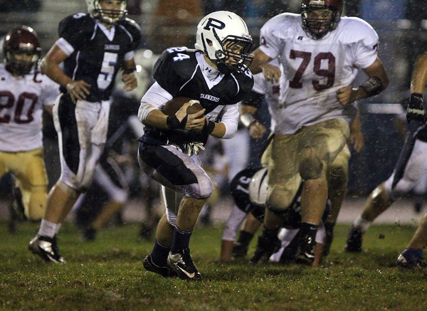 Peabody sophomore William Teehan looks for running room against Gloucester on Friday night. David Le/Staff Photo