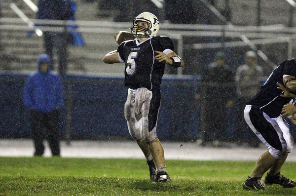 Peabody quarterback Cody Wlasuk drops back to pass against Gloucester on Friday night. David Le/Staff Photo