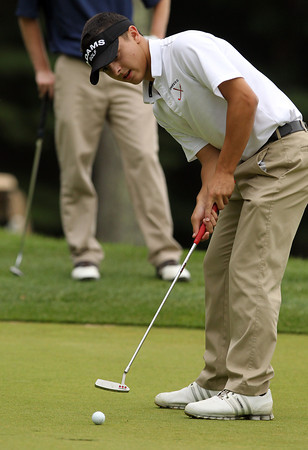 Ipswich High School junior Austin Rubino putts on the first green against Hamilton-Wenham on Wednesday afternoon. David Le/Staff Photo