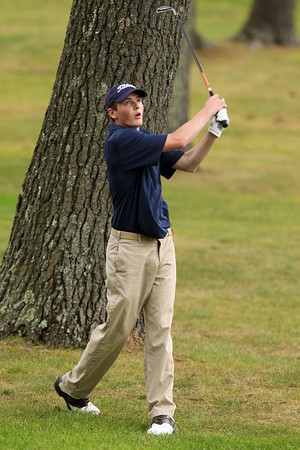 Hamilton-Wenham senior Spencer Bergholtz follows his shot from the rough while playing against Ipswich on Wednesday afternoon. David Le/Staff Photo