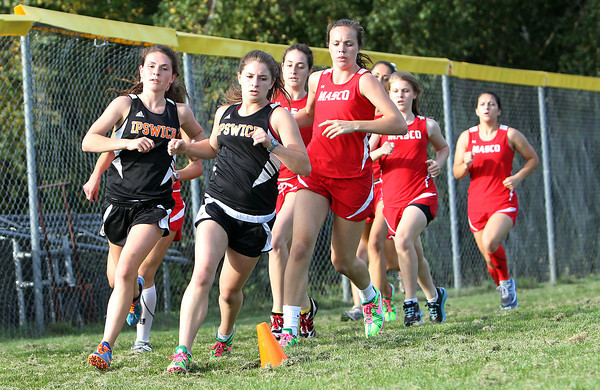 Ipswich seniors and twin sisters Sarah and Tina Keiran, left, lead a pack of Masco runners around the first corner during their meet on Wednesday afternoon. The Keiran twins finished 1-2 overall to pace the Tigers. David Le/Staff Photo