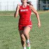 Masco sophomore Meghan Collins sprints to the finish line against Ipswich on Wednesday afternoon. David Le/Staff Photo