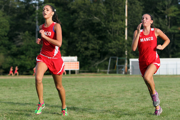 Masco senior Kali Volchok, left, and freshman Ally Goldstein, right, sprint down the home straightaway and towards the finish line during a meet with Ipswich on Wednesday afternoon. David Le/Staff Photo