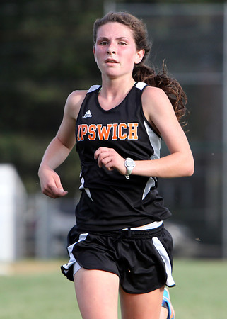 Ipswich senior captain Sarah Keiran sprints down the home straightaway to place first for the Tigers in a meet with Masco on Wednesday afternoon. David Le/Staff Photo