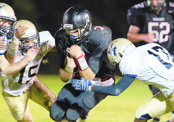 Marblehead senior Ian Maag braces for a hit from multiple Winthrop defenders on Friday night. David Le/Staff Photo
