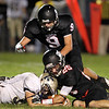 Marblehead's Zac Cuzner, right, and Will Millett, center, take down Winthrop running back Robert Diaz, left, after he fumbles on Friday evening. David Le/Staff Photo