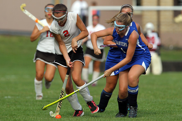 Marblehead's Eliza Fitzgerald, left, carries the ball upfield while being pressured by Danvers defender Julia Calascibetta, on Thursday afternoon. David Le/Staff Photo