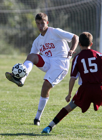 Masco junior midfielder Jeffrey Panella plays the ball on the volley upfield and around Newburyport's Matthew Cote, right, on Tuesday afternoon. David Le/Staff Photo