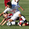 Masco senior Michael Ennis gets tripped up by Newburyport's Brendan Byron while jostling for possession on Tuesday afternoon. David Le/Staff Photo