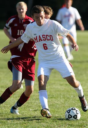Masco senior captain Chip Sherman unleashes a shot on net against Newburyport. David Le/Staff Photo
