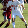 Masco senior captain Chip Sherman unleashes a shot on net against Newburyport. David Le/Staff Photo