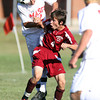 Masco junior Jack Heintzelman, left, steps in and wins a header over Newburyport's Connor Glynn during the first half of play on Tuesday afternoon. David Le/Staff Photo
