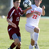 Masco junior Stephen Pease, right, and Newburyport sophomore Matthew Cote, left, battle for a loose ball on Tuesday afternoon. David Le/Staff Photo