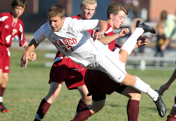 Masco junior midfielder Jeffrey Panella goes airborne as he makes a diving attempt to win a 50/50 ball against Newburyport on Tuesday afternoon. The Chieftans dominated play and defeated the Clippers 6-0. David Le/Staff Photo