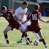 Masco junior midfielder Jeffrey Panella, center, tries to control the ball while being pressured by Newburyport's Thomas Graham, left, and Matthew Cote, right, on Tuesday afternoon. David Le/Staff Photo