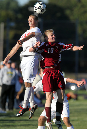 Masco junior midfielder Adam Grammer, left, leaps high in the air and wins a head ball over Newburyport's Jordan Steelman, right, on Tuesday afternoon. Grammer scored a goal for the Chieftans and they rolled to an easy 6-0 win. David Le/Staff Photo