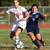 Masco senior captain Lexi Sheehan, left, and Triton sophomore Cara Orlandi, right, battle for a loose ball on Friday afternoon. The Chieftans held off a late rally from the Vikings to win 5-4. David Le/Staff Photo