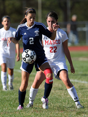 Masco senior captain Claudia Marsh, right, tightly marks Triton junior Shannon Dube, left, during the first half of the Chieftans 5-4 victory on Friday afternoon. David Le/Staff Photo