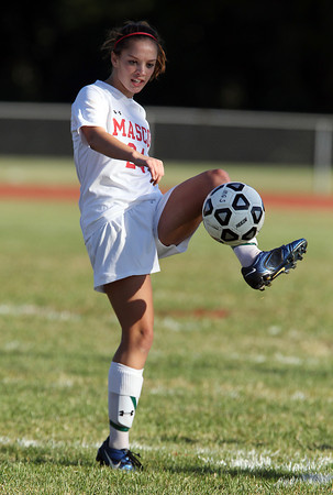 Masco senior midfielder Zoe Cennami intercepts and gains control of an aerial pass from a Triton player on Friday afternoon. David Le/Staff Photo