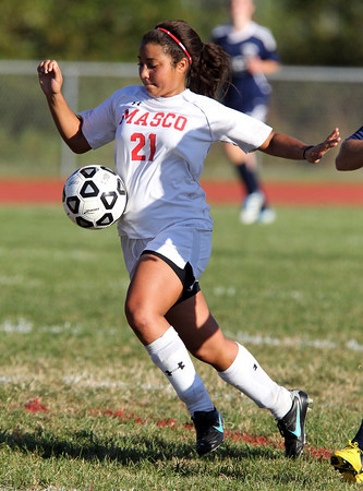 Senior forward Dominique Anderson tries to control the ball while playing against Triton on Friday afternoon. David Le/Staff Photo