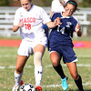 Masco senior Olivia Buonopane, left, shields the ball from Triton freshman Rylee Culverwell, right, on Friday afternoon. David Le/Staff Photo