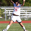 Masco senior captain Claudia Marsh reaches out to win a loose ball against Triton on Friday afternoon. David Le/Staff Photo