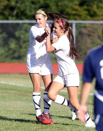Masco senior midfielder Jackie Dziadosz, right, gets a high five from teammate junior Sammi Sheehan, left, after she scored a goal against Triton on Friday afternoon. David Le/Staff Photo