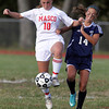 Masco senior captain Leah Connerty, left, shields the ball from Triton freshman Rylee Culverwell, right, on Friday afternoon.David Le/Staff Photo