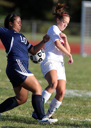Masco senior midfielder Zoe Cennami, right, and Triton senior Jessica Bannon battle for a 50/50 ball during the second half of their game on Friday afternoon. David Le/Staff Photo