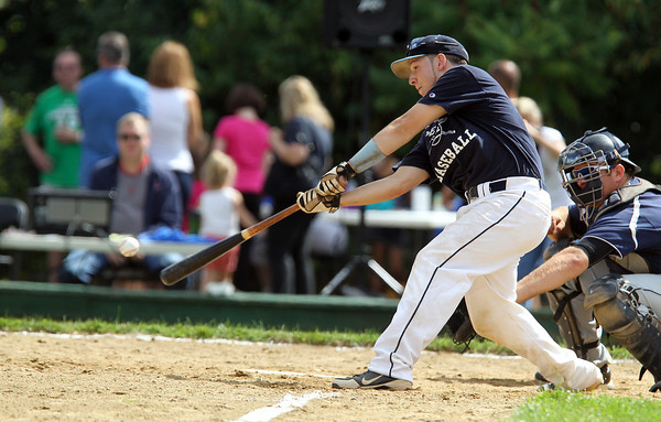 Peabody High School senior captain Matt McIsaac, makes contact with the ball while playing in the 56th Annual Peabody Police vs. NS Old Timers game at Emerson Park. David Le/Staff Photo