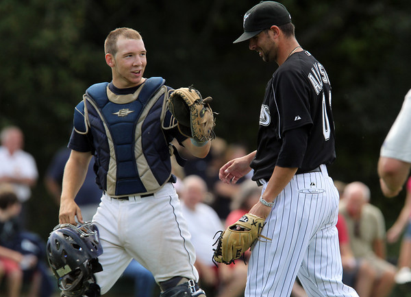 Peabody High School senior captain Matt McIsaac, left, jokes around with former Major Leaguer and Peabody High star Jeff Allison, after the bottom of the 6th inning. David Le/Staff Photo