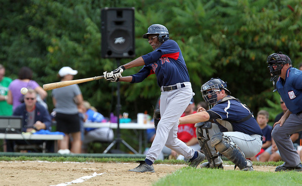 "Former Boston Red Sox star, Dennis ""Oil Can"" Boyd, connects for a hit while playing in the 56th Annual Peabody Police vs. NS Old Timers game on Labor Day Monday. David Le/Staff Photo"