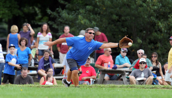 Peabody Police first baseman Marty Cohan stretches out far to snag an errant throw while playing in the Annual Labor Day game against the NS Old Timers. David Le/Staff Photo